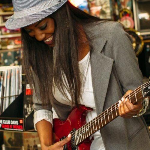 black-woman-playing-guitar-9838261