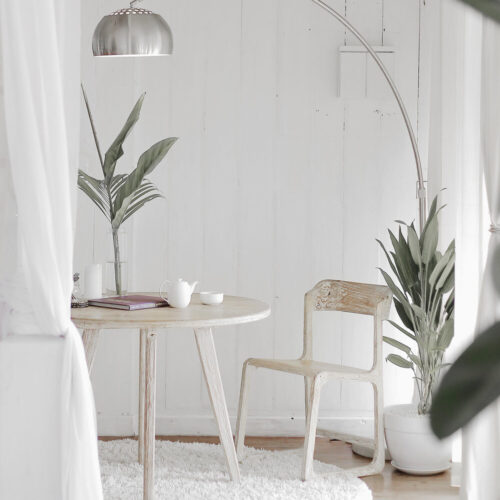 Natural color tables in white room with plants